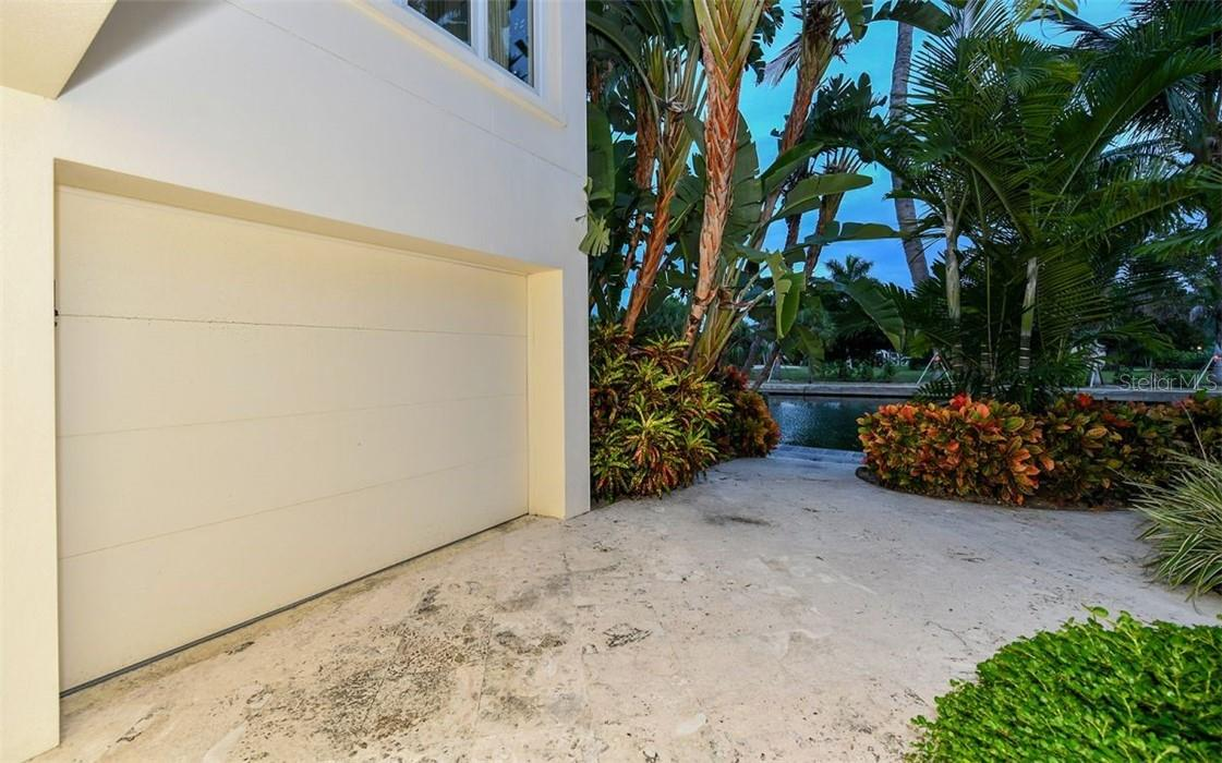 Water Garage for Kayaks and other water toys leading to dock - Single Family Home for sale at 612 Juan Anasco Dr, Longboat Key, FL 34228 - MLS Number is A4475444