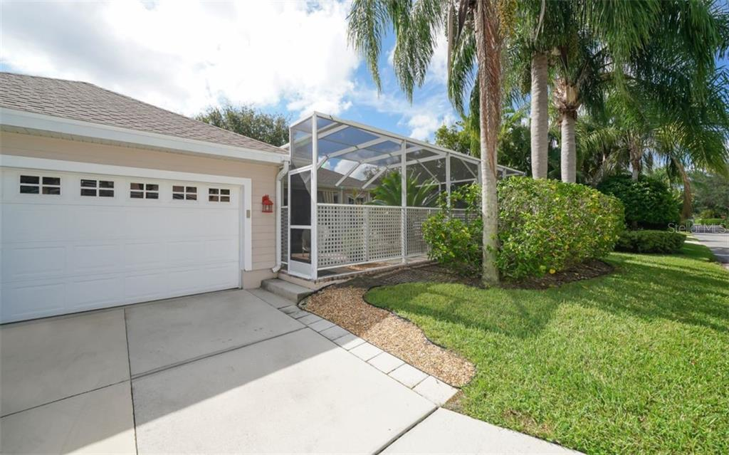 2 car garage, rear entrance to home - Single Family Home for sale at 759 Shadow Bay Way, Osprey, FL 34229 - MLS Number is A4478456