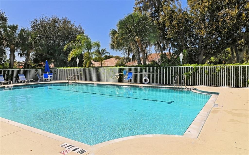 Heated community pool - Single Family Home for sale at 759 Shadow Bay Way, Osprey, FL 34229 - MLS Number is A4478456