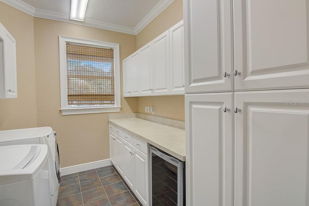 Upstairs laundry room with built in drink fridge - Single Family Home for sale at 1839 Buccaneer Ct, Sarasota, FL 34231 - MLS Number is A4479580
