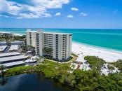 Set on a private beach at Whispering Sands - Condo for sale at 20 Whispering Sands Dr #301, Sarasota, FL 34242 - MLS Number is A4190302