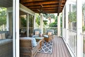 Lovely deck off the living room is ideal for grilling or just relaxing. - Single Family Home for sale at 3947 Somerset Dr, Sarasota, FL 34242 - MLS Number is A4201541