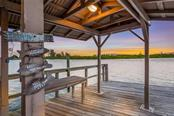 Covered party dock perfect for entertaining - Single Family Home for sale at 1253 Riegels Landing Dr, Sarasota, FL 34242 - MLS Number is A4203768