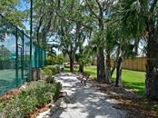 Tennis courts surrounded by nature - Single Family Home for sale at 4742 Mainsail Dr, Bradenton, FL 34208 - MLS Number is A4415119