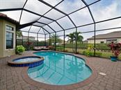 Corner lot with lush landscaping surrounded this entire pool area. Owners will consider selling all outside patio furniture as they are moving out of state. Fences are allowed. - Single Family Home for sale at 13707 Palazzo Ter, Bradenton, FL 34211 - MLS Number is A4427731