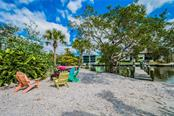 Single Family Home for sale at 9225 Blind Pass Rd, Sarasota, FL 34242 - MLS Number is A4438072