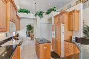Kitchen - Single Family Home for sale at 811 Jungle Queen Way, Longboat Key, FL 34228 - MLS Number is A4438987