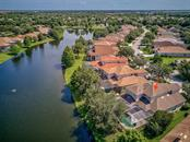 Aerial with lake - Single Family Home for sale at 6562 Field Sparrow Gln, Lakewood Ranch, FL 34202 - MLS Number is A4441603