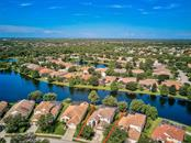 Aerial of Property and Lake - Single Family Home for sale at 6562 Field Sparrow Gln, Lakewood Ranch, FL 34202 - MLS Number is A4441603