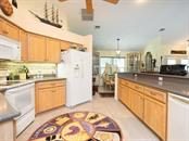 Solid wood cabinets - Single Family Home for sale at 1716 Bayshore Dr, Englewood, FL 34223 - MLS Number is A4445961