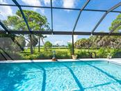 7 Ft deep pool with expansive garden views - Single Family Home for sale at 1716 Bayshore Dr, Englewood, FL 34223 - MLS Number is A4445961