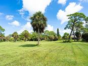 Eagles' nest in the pine tree - Single Family Home for sale at 1716 Bayshore Dr, Englewood, FL 34223 - MLS Number is A4445961