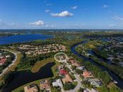 Aerial view of neighborhood and Braden River. Home at end of cut-de-sac - Single Family Home for sale at 6226 Stillwater Ct, University Park, FL 34201 - MLS Number is A4447872