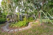 Fenced tropical landscaped backyard - Single Family Home for sale at 6524 Waterford Cir, Sarasota, FL 34238 - MLS Number is A4450568