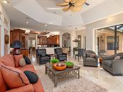 Family Room looking towards kitchen and breakfast nook - Single Family Home for sale at 6826 Turnberry Isle Ct, Lakewood Ranch, FL 34202 - MLS Number is A4450601
