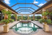 The family room opens fully to the lanai and pool - Single Family Home for sale at 15212 Linn Park Ter, Lakewood Ranch, FL 34202 - MLS Number is A4450793