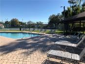View of pool and tennis courts - Townhouse for sale at 3434 51st Avenue Cir W, Bradenton, FL 34210 - MLS Number is A4454154