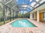 Large under roof space to dine and entertain!  Pool Bath is conveniently located behind the white door on the right.  Very rare to find this feature in a home! - Single Family Home for sale at 8111 Santa Rosa Ct, Sarasota, FL 34243 - MLS Number is A4454464