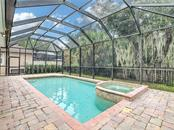 Stunning Herringbone Brick Paver Entry with Wrought Iron Entry Gate and Stack Brick Accents create a welcome that guests will remember long after their visit. - Single Family Home for sale at 8111 Santa Rosa Ct, Sarasota, FL 34243 - MLS Number is A4454464