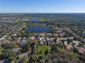 Aerial from rear - Single Family Home for sale at 6229 Yellow Wood Pl, Sarasota, FL 34241 - MLS Number is A4457471