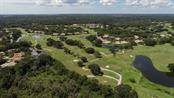 Aerial view of The Meadows showing ponds, lakes, acres of mature trees and three golf courses. - Townhouse for sale at 5319 Huntingwood Ct #51, Sarasota, FL 34235 - MLS Number is A4460231