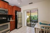 Kitchen with view through sliders to private courtyard. - Townhouse for sale at 5319 Huntingwood Ct #51, Sarasota, FL 34235 - MLS Number is A4460231