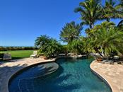 Tropical Pool - Single Family Home for sale at 6301 Gulf Of Mexico Dr, Longboat Key, FL 34228 - MLS Number is A4460816