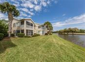 Rear exterior - Condo for sale at 119 Woodbridge Dr #204, Venice, FL 34293 - MLS Number is A4461406