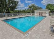 Community pool - Condo for sale at 119 Woodbridge Dr #204, Venice, FL 34293 - MLS Number is A4461406