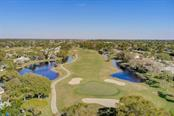 Golf course behind pool which is behind the home from Aerial Drone - Condo for sale at 2319 Lakeside Mews #B3, Sarasota, FL 34235 - MLS Number is A4462396