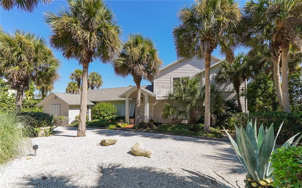 Front of home with circular drive. - Single Family Home for sale at 3509 Casey Key Rd, Nokomis, FL 34275 - MLS Number is N5915098
