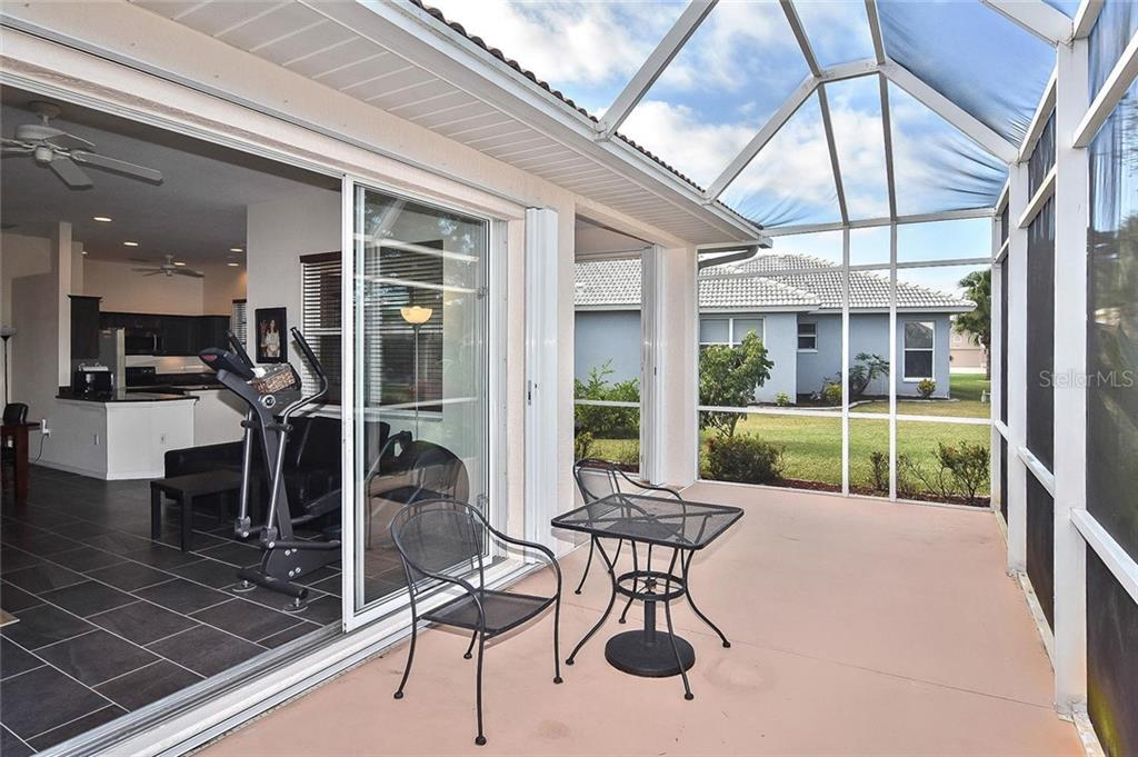 Lanai to great room - Single Family Home for sale at 724 Silk Oak Dr, Venice, FL 34293 - MLS Number is N6102801