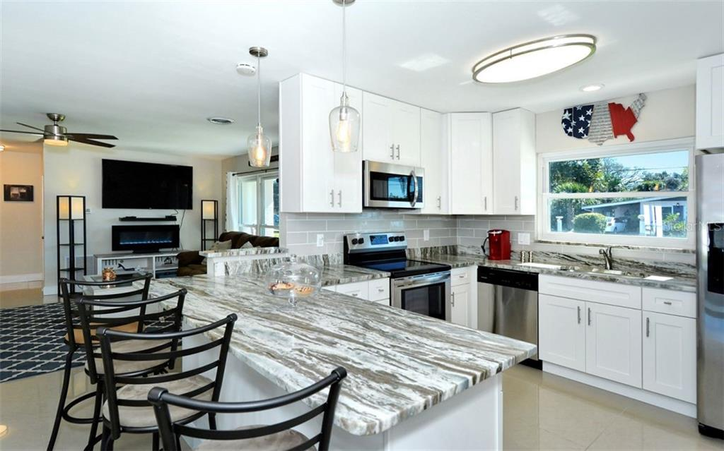 Kitchen - Single Family Home for sale at 227 Redwood Rd, Venice, FL 34293 - MLS Number is N6103942