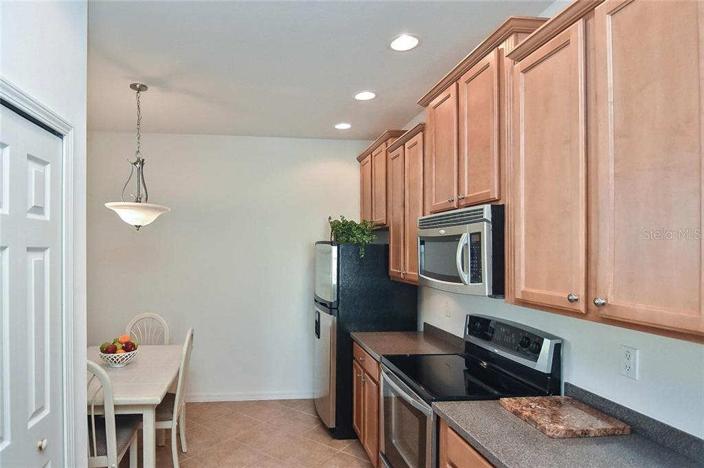 Eat in kitchen - Villa for sale at 11108 Batello Dr, Venice, FL 34292 - MLS Number is N6104651