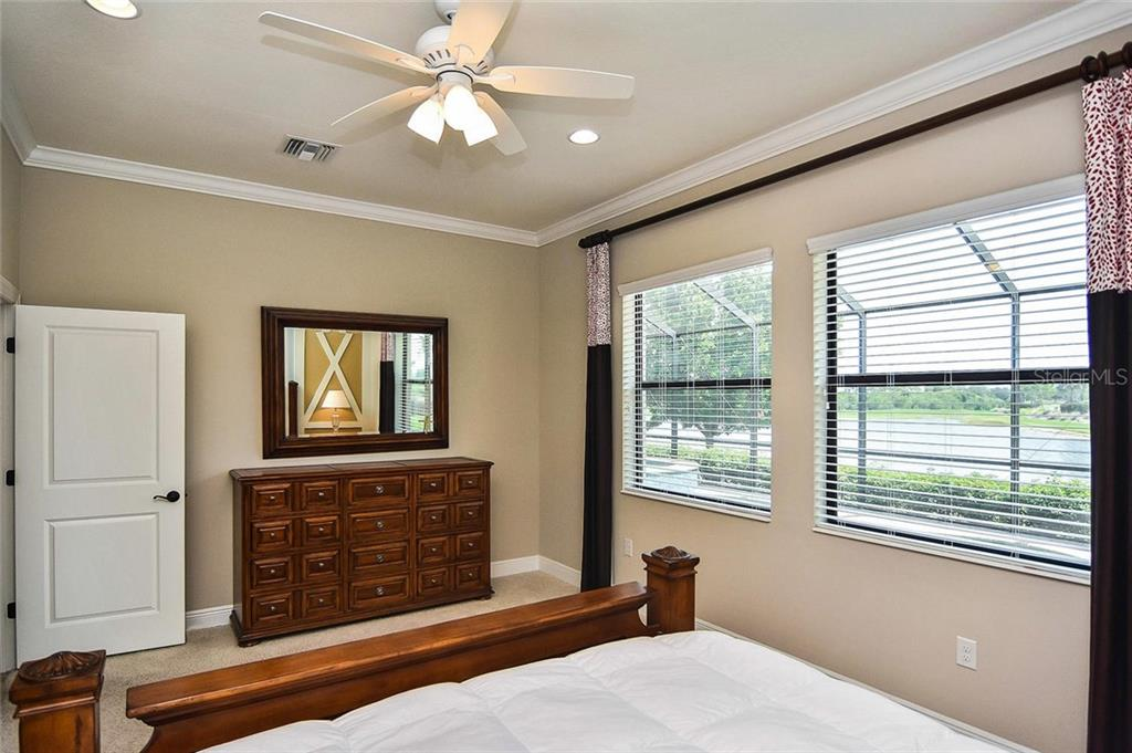 Master bedroom with lake view - Single Family Home for sale at 23763 Waverly Cir, Venice, FL 34293 - MLS Number is N6107580