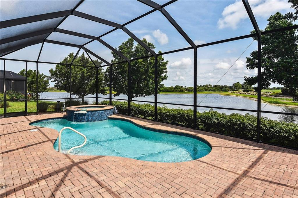 Pool with lake view - Single Family Home for sale at 23763 Waverly Cir, Venice, FL 34293 - MLS Number is N6107580