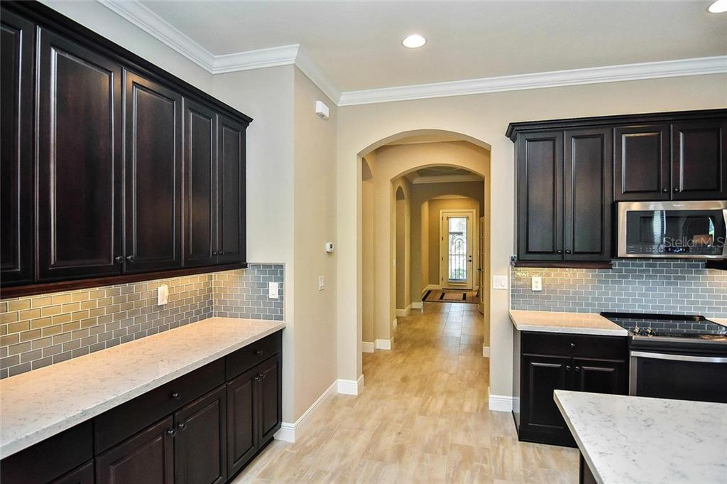 Kitchen to foyer - Single Family Home for sale at 23763 Waverly Cir, Venice, FL 34293 - MLS Number is N6107580