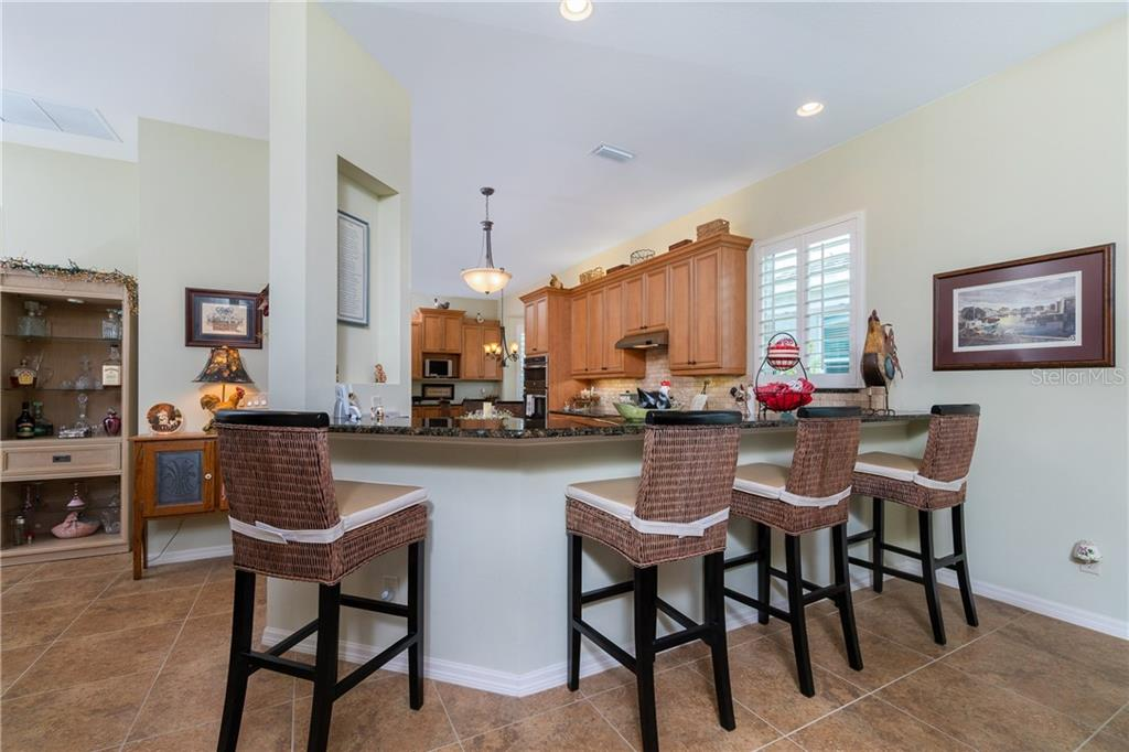Breakfast bar to kitchen - Single Family Home for sale at 11017 Barnsley Dr, Venice, FL 34293 - MLS Number is N6108867