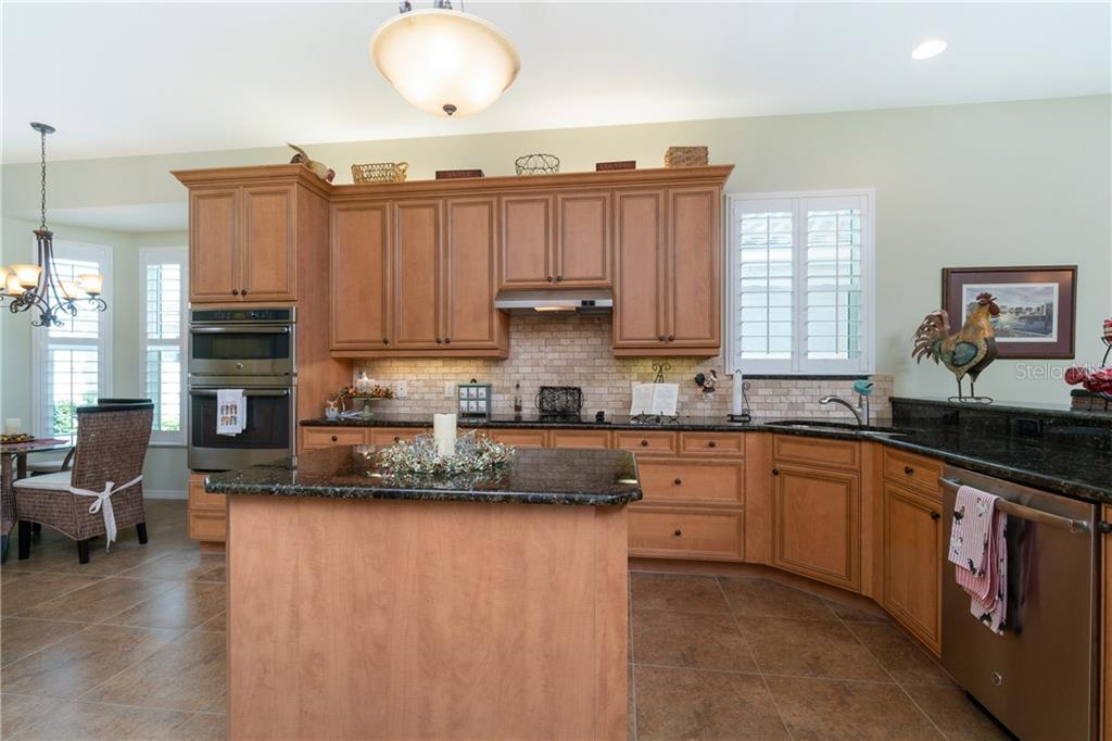 Entertainers kitchen - Single Family Home for sale at 11017 Barnsley Dr, Venice, FL 34293 - MLS Number is N6108867