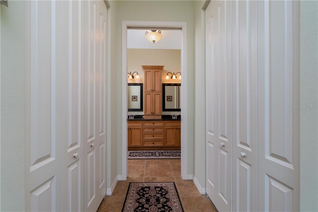 Master walk in closets on each side facing en-suite - Single Family Home for sale at 11017 Barnsley Dr, Venice, FL 34293 - MLS Number is N6108867