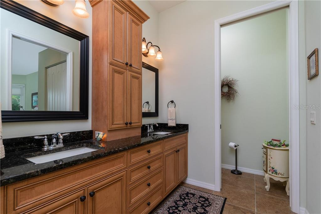 Master double vanity and private water closet entrance - Single Family Home for sale at 11017 Barnsley Dr, Venice, FL 34293 - MLS Number is N6108867