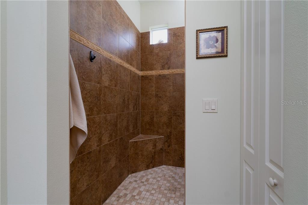 Master walk in shower - Single Family Home for sale at 11017 Barnsley Dr, Venice, FL 34293 - MLS Number is N6108867