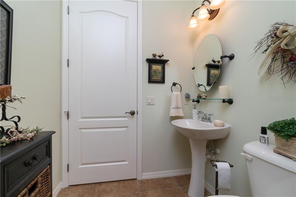 1/2 bath/ powder room - Single Family Home for sale at 11017 Barnsley Dr, Venice, FL 34293 - MLS Number is N6108867