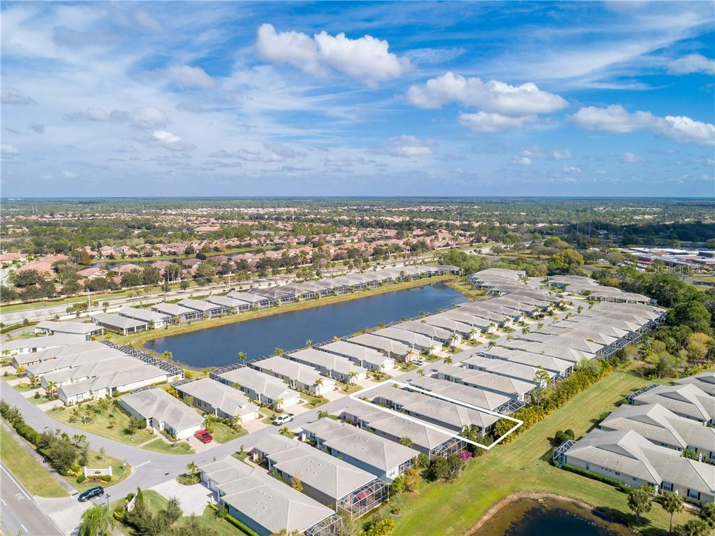 Aerial view of home with privacy, but lake view - Single Family Home for sale at 11017 Barnsley Dr, Venice, FL 34293 - MLS Number is N6108867