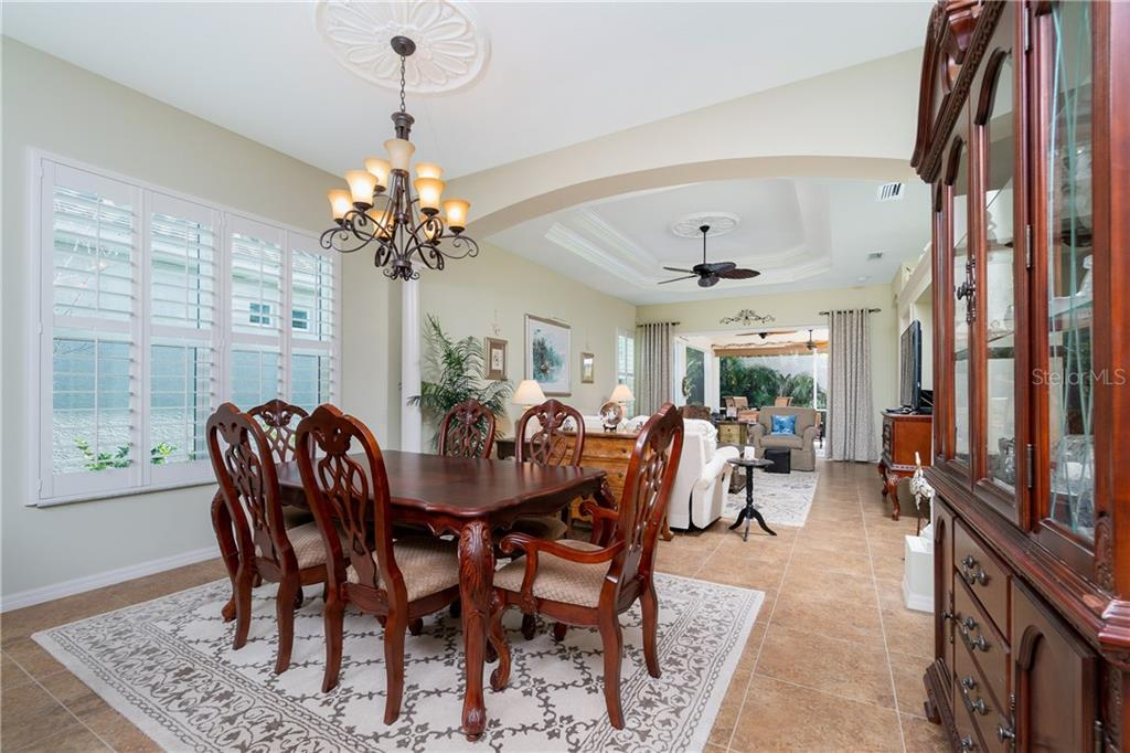 Dining area to living room to lanai - Single Family Home for sale at 11017 Barnsley Dr, Venice, FL 34293 - MLS Number is N6108867