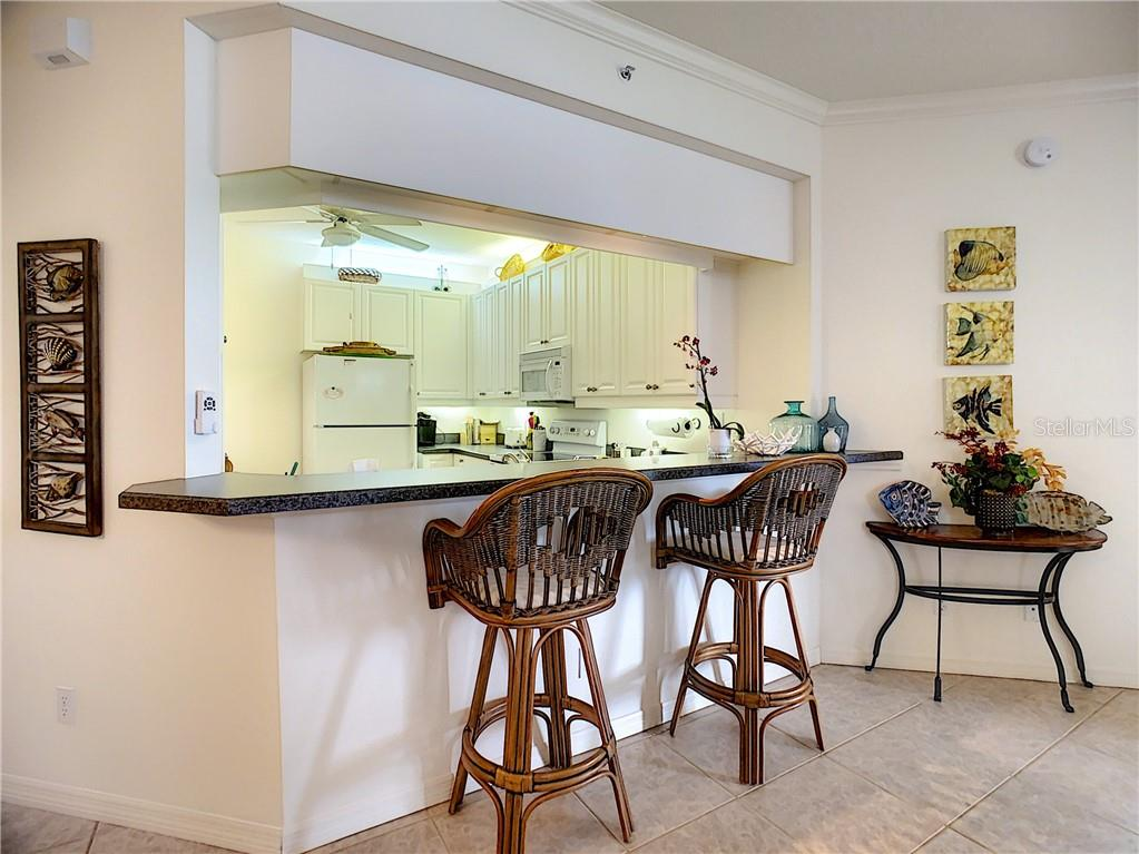 Breakfast bar - Condo for sale at 115 Woodbridge Dr #104, Venice, FL 34293 - MLS Number is N6108875
