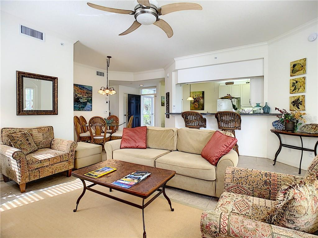 Living room - Condo for sale at 115 Woodbridge Dr #104, Venice, FL 34293 - MLS Number is N6108875