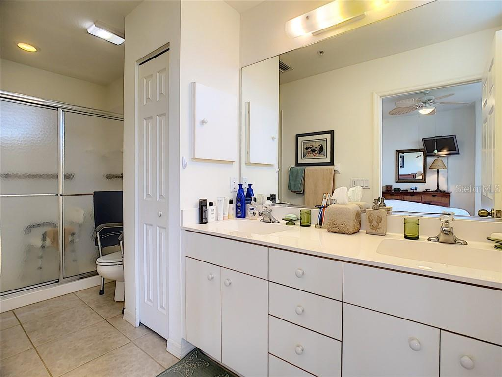 Master bathroom.  Dual sinks, shower - Condo for sale at 115 Woodbridge Dr #104, Venice, FL 34293 - MLS Number is N6108875
