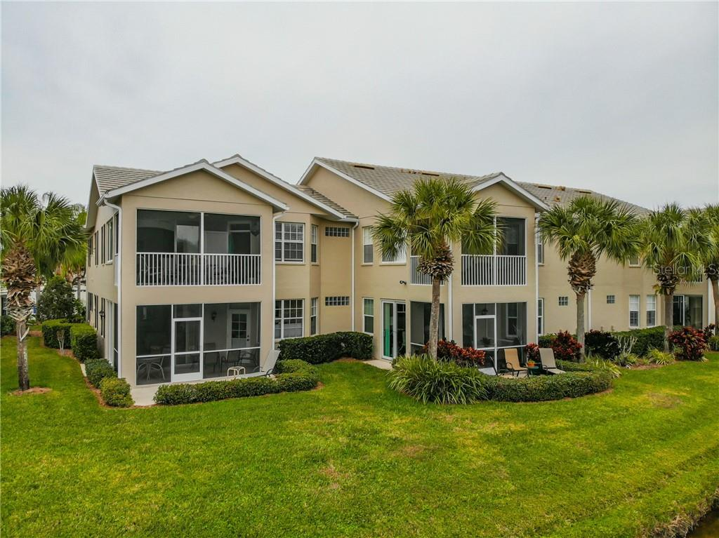 Exterior rear. - Condo for sale at 115 Woodbridge Dr #104, Venice, FL 34293 - MLS Number is N6108875