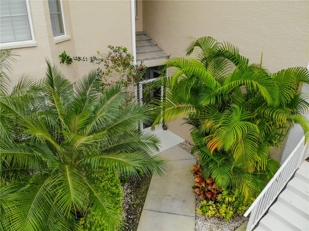 Ground Floor end unit with tropical approach. - Condo for sale at 115 Woodbridge Dr #104, Venice, FL 34293 - MLS Number is N6108875